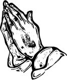 Woodcut Hands in Prayer. A black and white woodcut style drawing of praying hands. Hand drawn to resemble a woodcut illustration Royalty Free Stock Photos