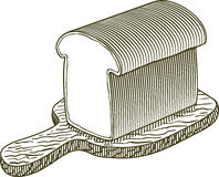 Woodcut Loaf of Bread. Woodcut-style illustration of a loaf of bread on a cutting board Royalty Free Stock Image