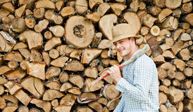 Woodcutter with straw hat on a background of wood Stock Photos