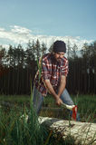 Woodcutter with Beard, Hat and Shirt cut a Tree Royalty Free Stock Photo