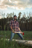 Woodcutter in Hat holding a big Ax in one Hands Stock Photography