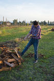 Woodcutter. Lumberman cuts wood with his strong axe Stock Photo