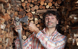 Woodcutter sharpening the axe Stock Photos