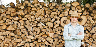 Woodcutter with straw hat on a background of wood Royalty Free Stock Photo