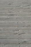 Woodden sube a gris como fondo Imagen de archivo