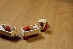 Woodden train. Toy on parquet stock photo