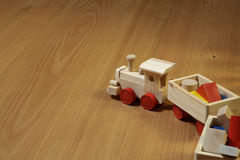 Woodden train. Toy on parquet stock photos
