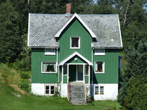 Woode house. Beautiful green house in Norway Stock Photography