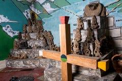 Woode mayan cross in praying room Stock Image