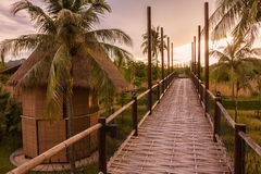 Wooded bridge and hut between sunrise Royalty Free Stock Images