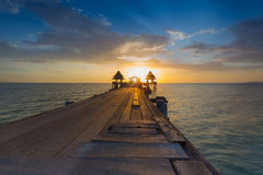 Wooded bridge in the port through the sea Stock Images