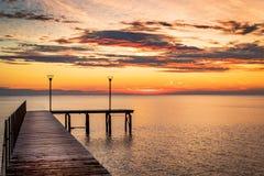 Wooded bridge. Wooded bridge in the port between sunrise Stock Image