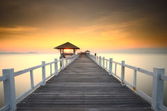 Wooded bridge in the port between sunrise. Royalty Free Stock Photo