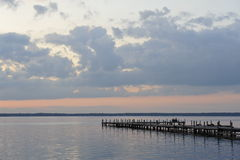 Wooded Bridge in the port between sunrise. Royalty Free Stock Photos