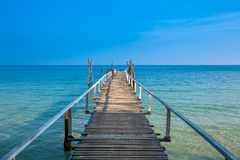 Wooded bridge into the sea Royalty Free Stock Photo
