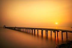 Wooded bridge at sunset Stock Photo