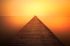Wooded bridge at sunset Stock Photography