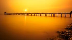 Wooded bridge at sunset Royalty Free Stock Photography