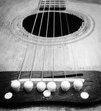 Wooded guitar. An up close black and white photo of a wooden guitar stock photo