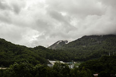 Wooded mountains in the rainy weather in Sochi. Mountains in the rainy weather in Sochi Royalty Free Stock Photography