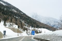 A wooded mountainside. View from the car on the roads and the city royalty free stock photography