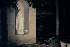 Wooded outdoor shrine to Mother Mary at night Royalty Free Stock Photography