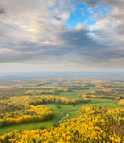Wooded terrain with river in autumn, top view Royalty Free Stock Image