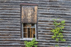 Wooded Window on Collapsing Building Royalty Free Stock Image