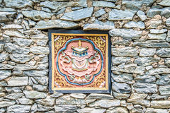 Wooded window and rock wall from bhutan Stock Images