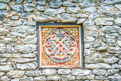 Wooded window and rock wall from bhutan Royalty Free Stock Photography