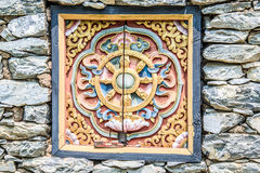 Wooded window and rock wall from bhutan Royalty Free Stock Image