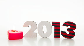 Wooden 2013 year number with a burning candle Stock Images