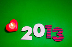 Wooden 2013 year number with a burning candle Stock Photo