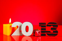 Wooden 2013 year number with a burning candle Royalty Free Stock Images