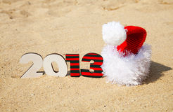 Wooden 2013 year number and Santa's hat Stock Photography
