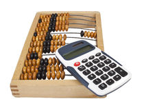Wooden abacus. Old wooden abacus and modern calculator isolated Stock Photography