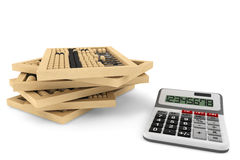 Wooden abacus and calculator Royalty Free Stock Image