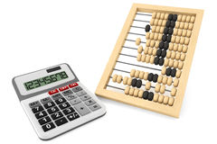 Wooden abacus and calculator Royalty Free Stock Images