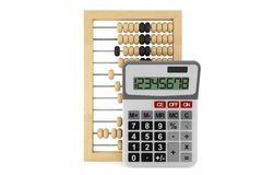 Wooden abacus and calculator Royalty Free Stock Photos