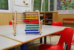 Wooden abacus in the classroom to learn decimal numeral system. To children royalty free stock image