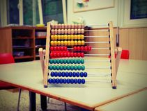 Wooden abacus in the classroom to learn decimal numeral system w. Wooden abacus in the classroom to learn decimal numeral system to children with vintage old stock images