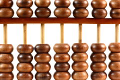 Wooden Abacus Close Up. A close up shot of a wooden Chinese abacus in front of a white background Stock Photos