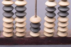 Wooden abacus fragment. Vintage wooden abacus fragment with focus on beads Royalty Free Stock Photos