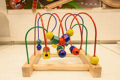 Wooden abacus or geometric counting toy Royalty Free Stock Photo