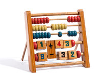 Wooden abacus with numbers and counters. Wooden abacus with numbers and three rows of different coloured counters for manual computing isolated on a white stock photography