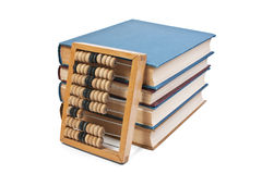 Wooden abacus on a pile of books Stock Image