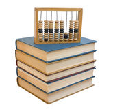 Wooden abacus on a pile of books Royalty Free Stock Photo