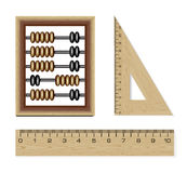 Wooden abacus and rulers. Isolated on white background Royalty Free Stock Photo