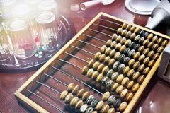Wooden abacus in shop. Vintage wooden abacus in shop royalty free stock photo