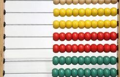 Wooden abacus to count the balls. And learn to do math operations royalty free stock photography
